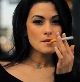 woman vaping Green Smoke ecigarette